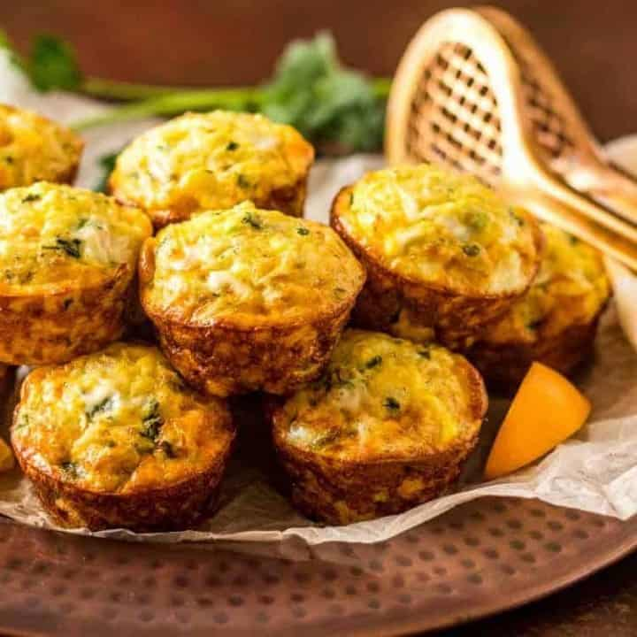 Healthy Mediterranean Rice and Chick Pea Mini-Fritattas - egg muffins stacked on a copper platter - feature image.