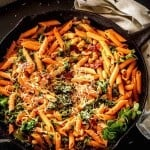 Instant Pot Cannelini Beans with Penne, Arugula, and Slow Roasted Tomatoes - square feature image in cast iron skillet.