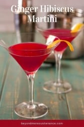 Ginger Hibiscus Martini in 2 martini glasses with twists.
