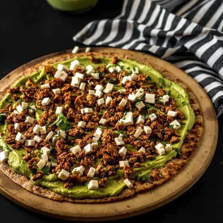 Mexican Grilled Pizza with Shrimp Ceviche and Avocado Hummus - flatbread crust with avocado hummus, chorizo, and queso fresco.