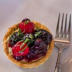 Gluten Free Tarts with Vanilla Pudding, Berries, and a Hibiscus Glaze