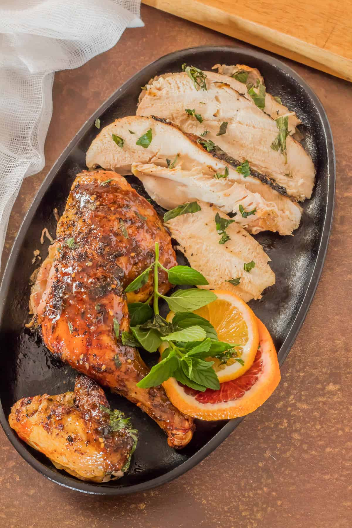 Butterflied and Grilled Za'atar Chicken - Chicken sliced for serving in a cast iron plate.