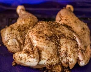 The butterflied and grilled za'atar chicken is rubbed with the za'atar spice mix, and prepped to go on the grill.