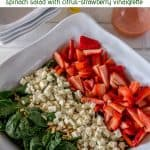 Mexican Flag Salad pin of a big white salad bowl with spinach, feta, strawberries, almonds.