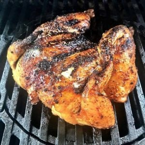 The whole butterflied (spatchcocked) za'atar chicken on the gas grill.