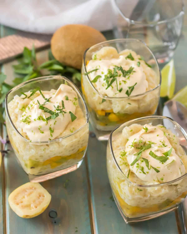Tropical Tapioca Parfaits with Mango and Mascarpone - 3 glasses with tropical parfaits, mint and Thai basil, kiwi...
