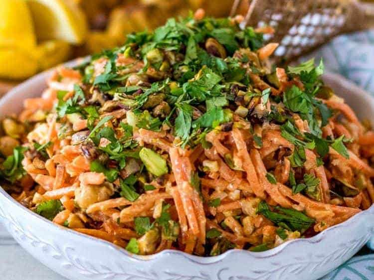 Moroccan Carrot Salad with Chickpeas and Feta - A close up of a white bowl with the Moroccan