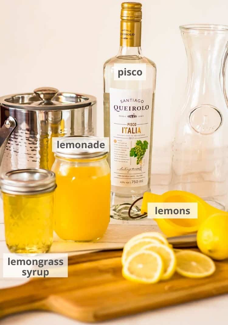 Pisco Lemonade with Lemongrass and Mint - cutting board, lemons, syrup, juice, pisco, ready to shake up a pisco cocktail!
