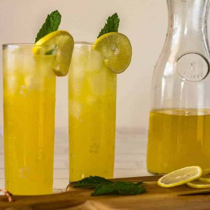 Pisco Lemonade with Lemongrass and Mint - square image with 2 glasses of pisco lemonade.