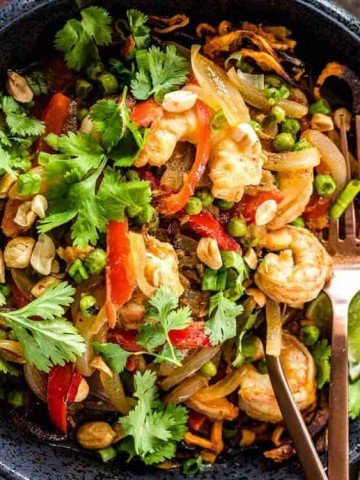 Thai Sweet Potato Noodle Bowls with Shrimp and Peas - A square image with a black bowl and curry.