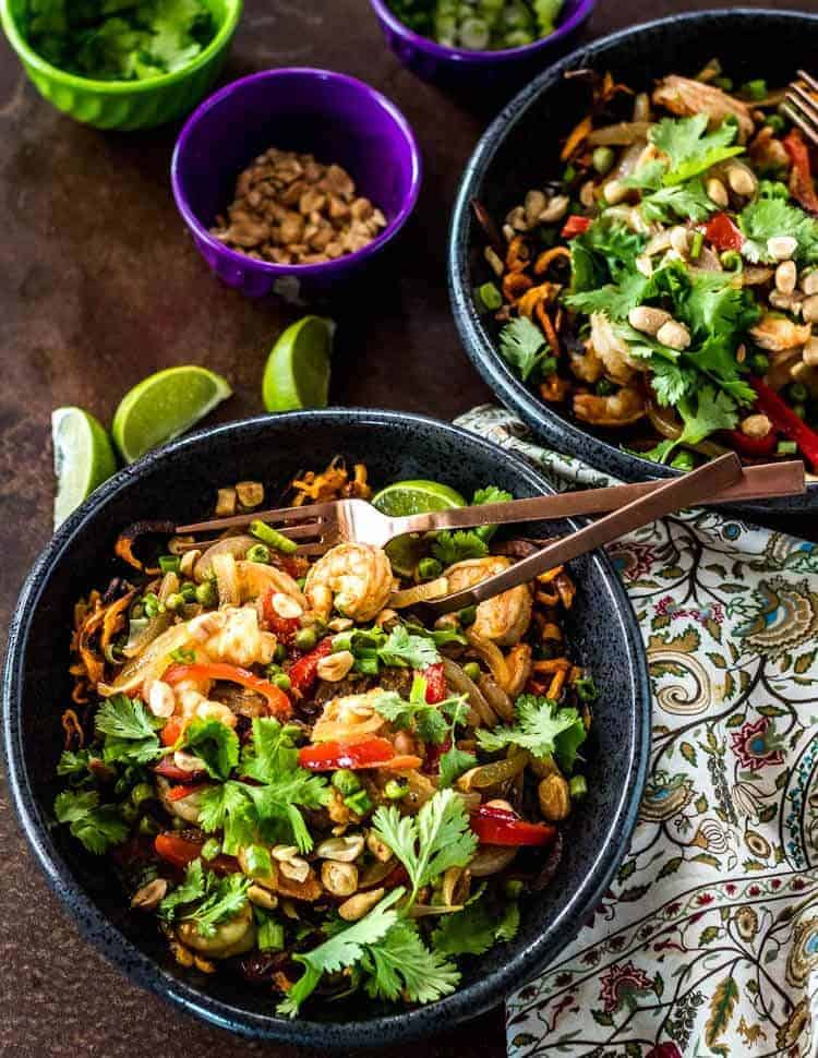 Thai Sweet Potato Noodle Bowls with Shrimp and Peas - A black stoneware bowl with the spiralized sweet potatoes and Thai shrimp and peas curry.