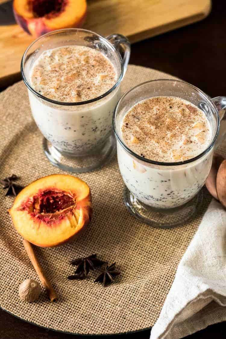 Peruvian Quinoa Porridge with Peaches - 2 mugs of quinoa porridge and half a peach.