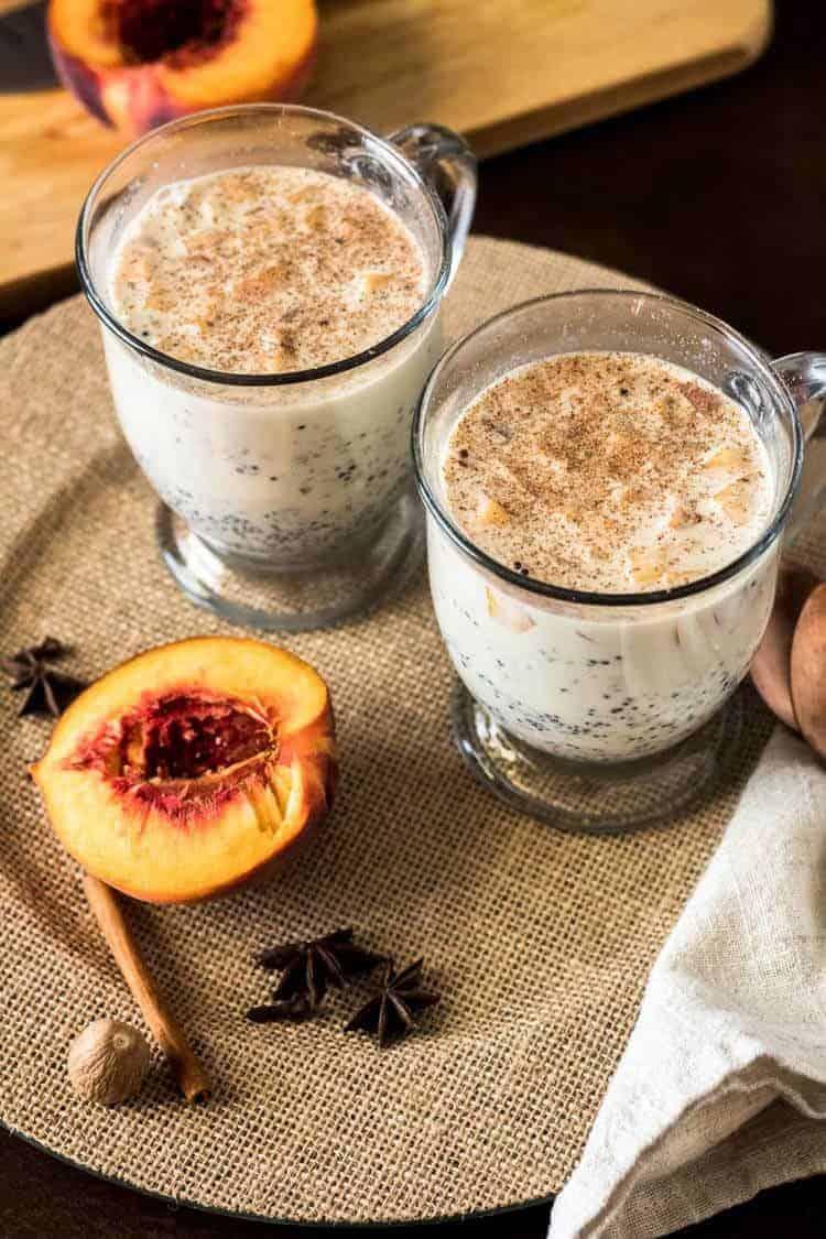 Peruvian Quinoa Porridge with Peaches - 2 mugs of quinoa porridge and half a peach.