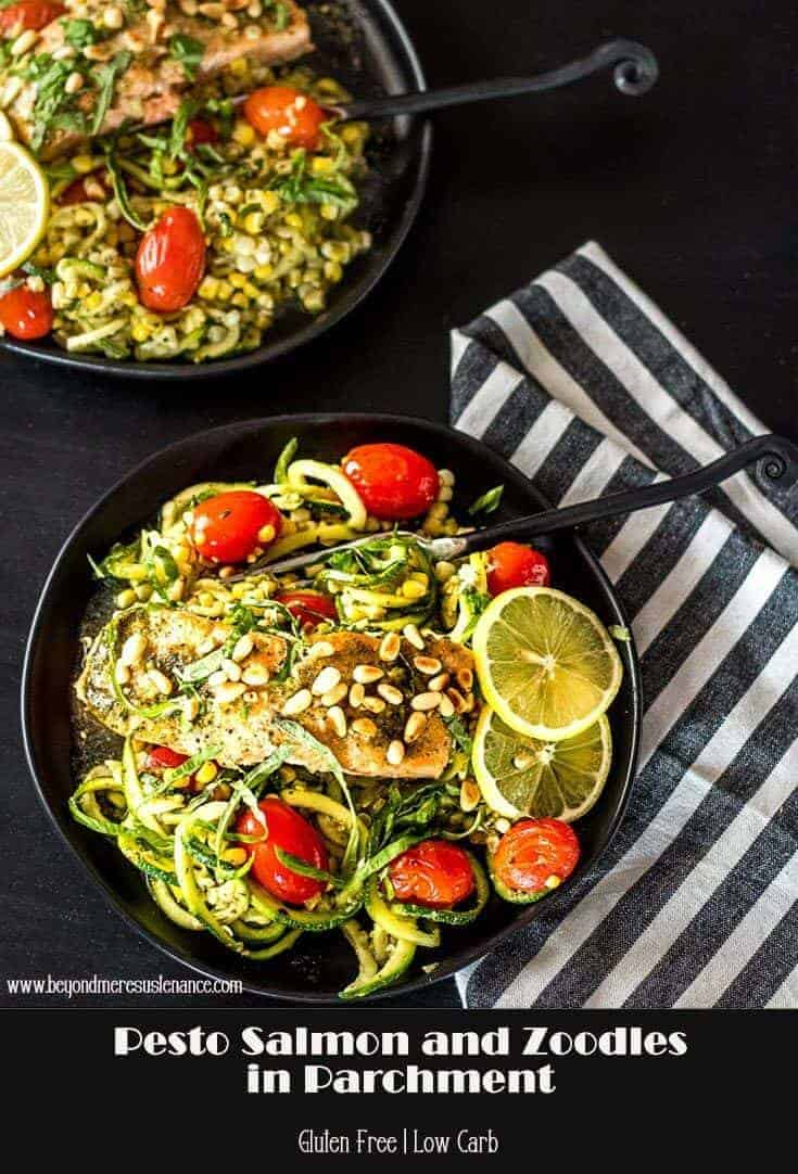 Are you looking to increase healthy and sustainable seafood in your diet, but out of quick and easy ideas? This Pesto Salmon and Zoodles in Parchment features frozen (or fresh) salmon with spiralized zucchini noodles, tiny tomatoes, and corn all tossed with  pesto. Garnished with fresh lemon, basil and toasted pinons, and this dish is elegant enough for company but easy enough for weeknight supper! #Seafood2xWk #seafood #salmon #zoodles #fishinparchment #glutenfree #AD