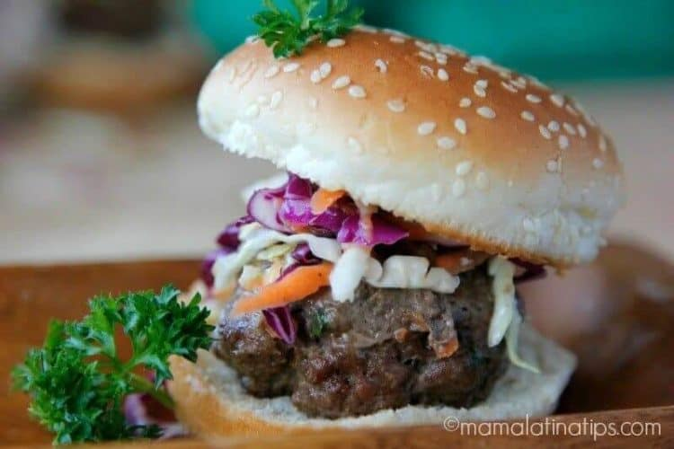 Jamaican Beef Sliders with slaw on a bun.