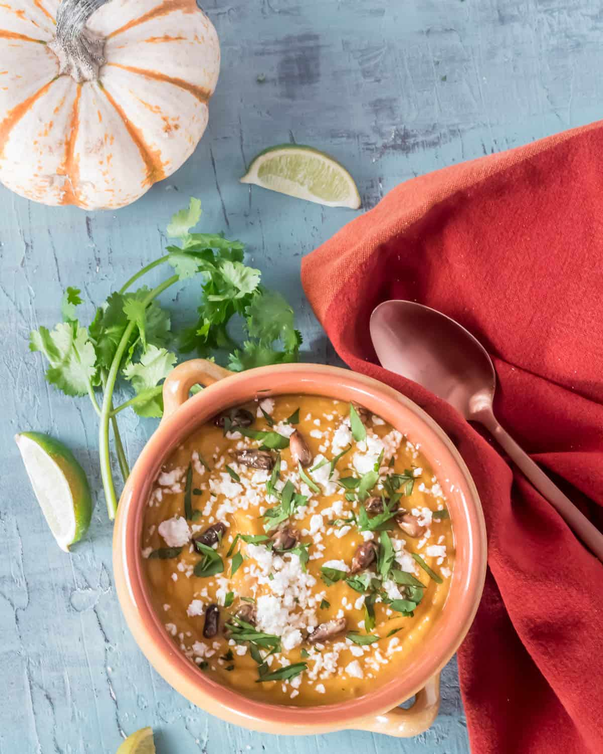 A creamy and savory soup with a hint of spice and sweetness, Peruvian Pumpkin Soup - Sopa de Calabaza makes a stunning first course (especially when served in a mini pumpkin bowl) or a comforting light supper on a chilly fall evening! Isn't it time to expand your use of pumpkins beyond jack o'lanterns and pies? #pumpkinsouprecipe #Peruvianpumpkinsoup