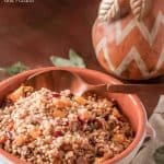 Healthy, fiber-rich, and delicious,Herbed Farro Dressing with Butternut Squash, Dried Cherries, and Pecans has all the flavors of fall in a Thanksgiving side dish that can be made ahead and makes great leftovers! Are you ready to try a less traditional dressing? This one is a winner! #farrorecipes #farrodressing #Thanksgivingsides #healthysides #wholegraindressing #cleaneating #butternutsquashrecipes