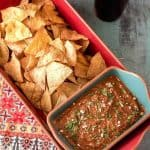"""Not your """"standard"""" salsa, Red Chile and Toasted Pumpkin Seed Salsa features red chile sauce, pepitas (pumpkin seeds), and tomatoes. the earthy flavor with just a hint of heat will up your salsa game! Serve alongside baked tortilla chips for a wholesome party appetizer or snack... #glutenfree #vegan #vegetarian #salsarecipes #pumpkinseedsalsa #pepitas #Latinsalsarecipe"""