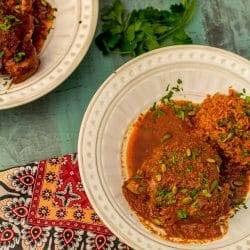 Latin Braised Turkey Thighs in Pumpkin Seed Red Chile Sauce