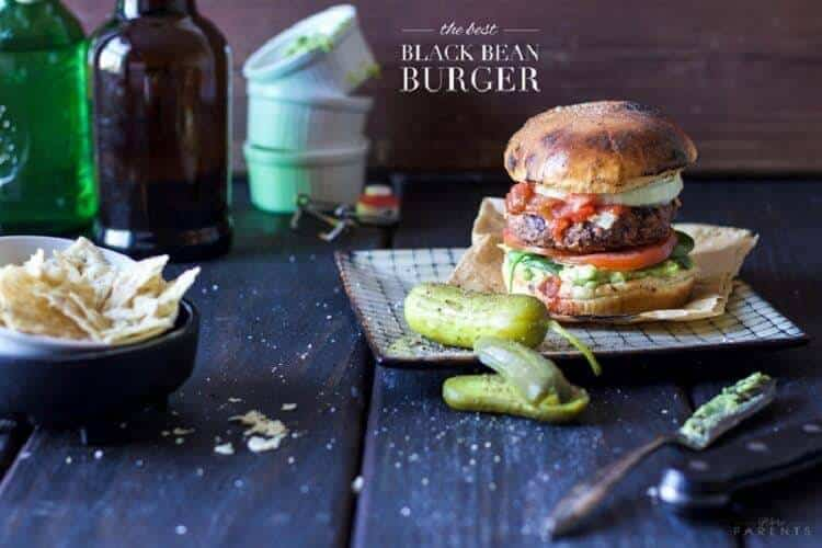 Best Black Bean Burger on a wood table with condiments.