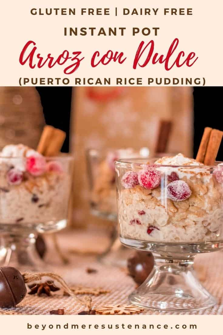 2 glass trifle bowls with instant pot arroz con dulce garnished with candied fresh cranberries and cinnamon stick.