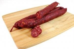 Spanish chorizo links on a cutting board.