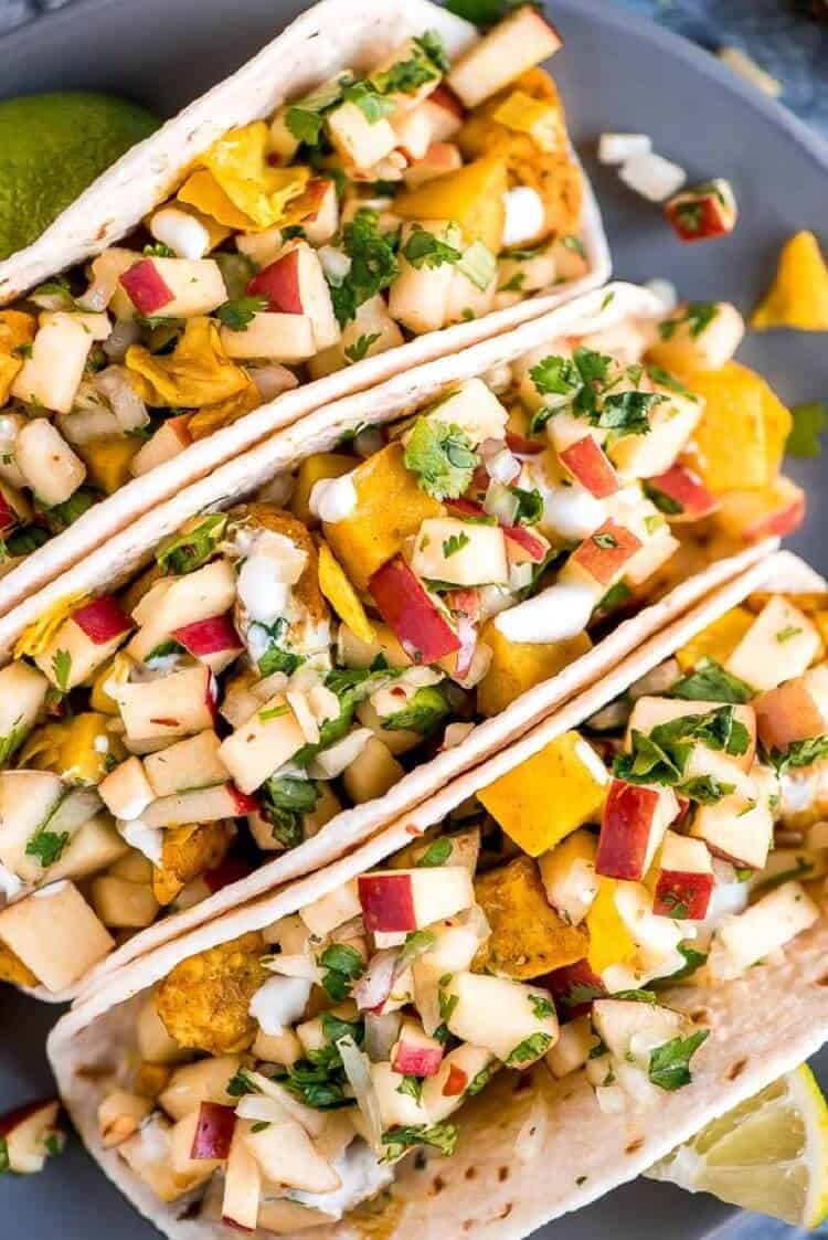 Chicken Cabbage Potato Tacos in flour tortillas with toppings.