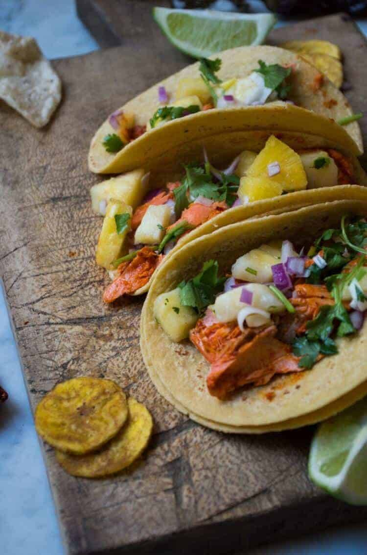 Fish Tacos al Pastor in corn tortillas with toppings.