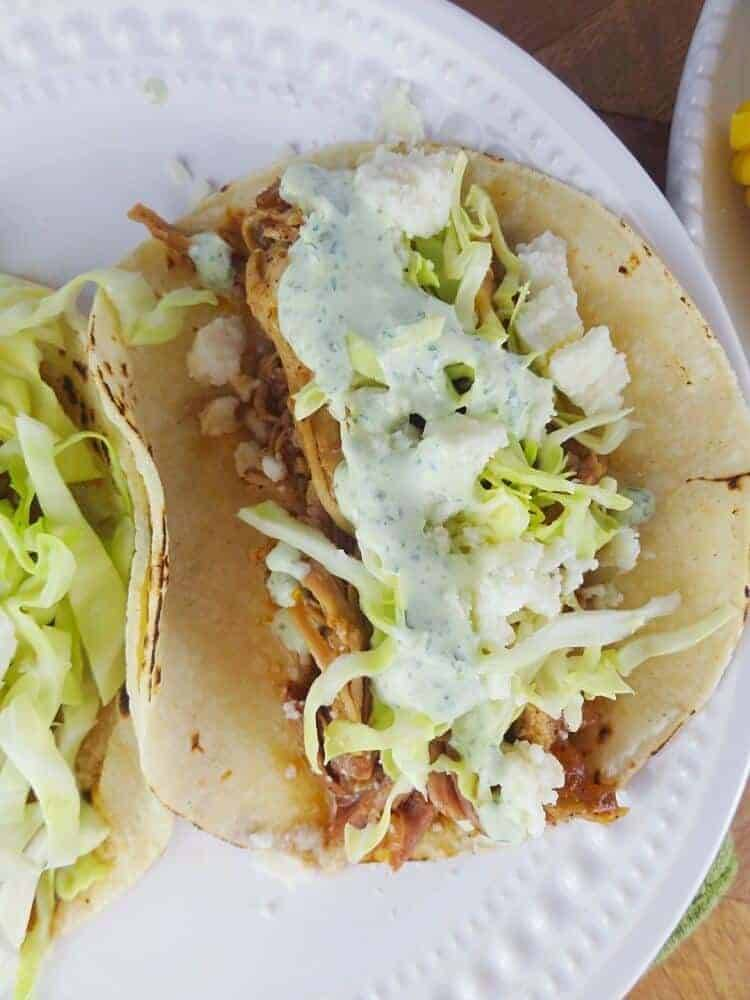 Irish Tacos with crema and slaw in corn tortillas.
