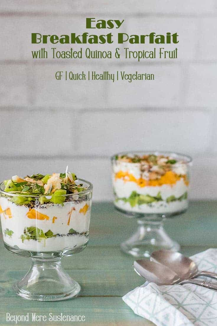 Easy breakfast parfait with layers of tropical fruit, toasted quinoa, and coconut yogurt in 2 parfait glasses.