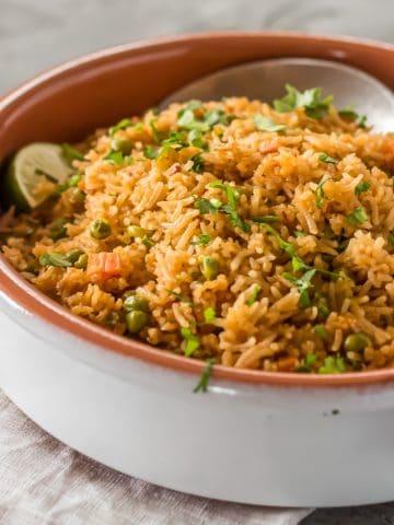 Mexican Red Rice in a terra cotta cazuela.