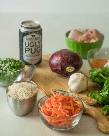The ingredients for Arroz con Pollo - shredded carrots, rice, peas, beer, onion garlic, cilantro chicken, aji amarillo paste...