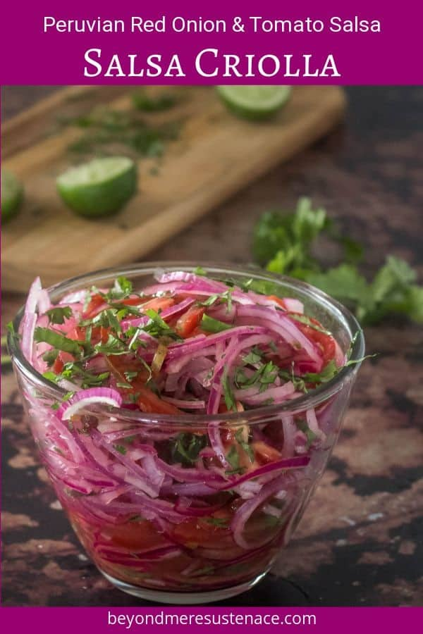 A Pinterest pin of salsa criolla in a clear glass bowl with cilantro and limes.