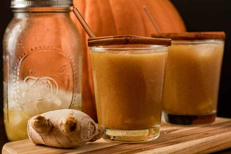 Pumpkin Kentucky Mule in a rocks glass with cinnamon and candied ginger.