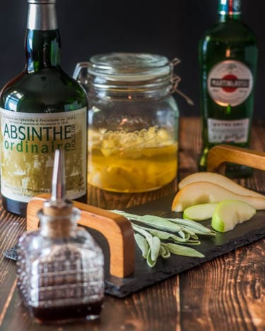Gather ingredients - apple and pear infused gin, absinthe, white vermouth, fresh sage, fresh apple and pear for garnish... Cardamom bitters at the ready.