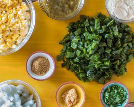 Ingredients for Gluten Free Corn Chowder with Green Chile: chopped green chile, corn, onion, garlic, masa, cumin, salsa verde, broth/stock, coconut creamer or half n' half.