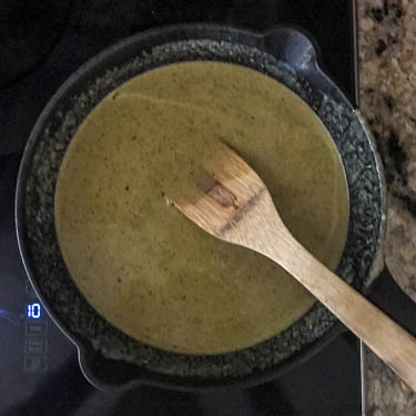 Making the mole verde step 3: Fry the puréed salsa verde and tahini with the garlic and cumin.