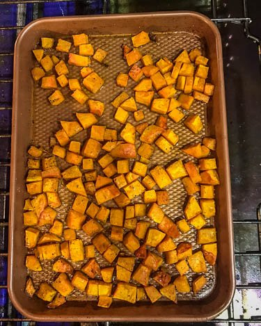 Step 2: Roasted veggies on a copper baking sheet after roasting 20-30 minutes... edges are caramelized and butternut squash is tender.