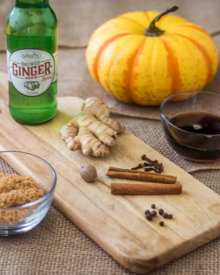 Ingredients for Instant Pot Pumpkin Butter: A carnival pumpkin, maple syrup, whole spices, brown sugar, ginger, and ginger beer.