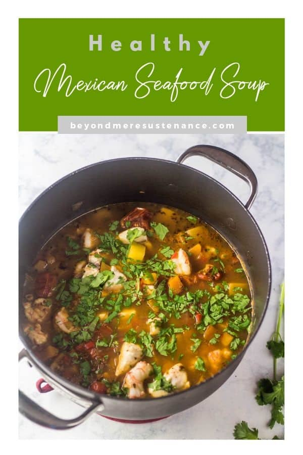 A soup pot full of gluten free Healthy Mexican Seafood Soup on a marble background with a green title block.