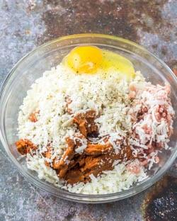 Chorizo, ground turkey, cotija, tortilla crumbs, beaten egg, salt and pepper in a mixing bowl.