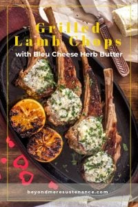Grilled lamb chops with compound butter on an oval cast iron plate with glitter hearts.