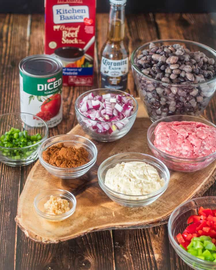 Ingredients for instant pot ground lamb chili: cooked beans, ground lamb, masa, bell pepper, garlic, spice blend, onion, canned tomatoes, beef broth, beer.