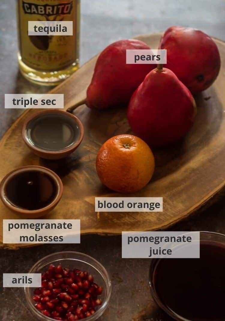 ingredients for spiced tequila poached pears: pears, blood orange, pomegranate juice, molasses, and arils, triple sec, tequila.