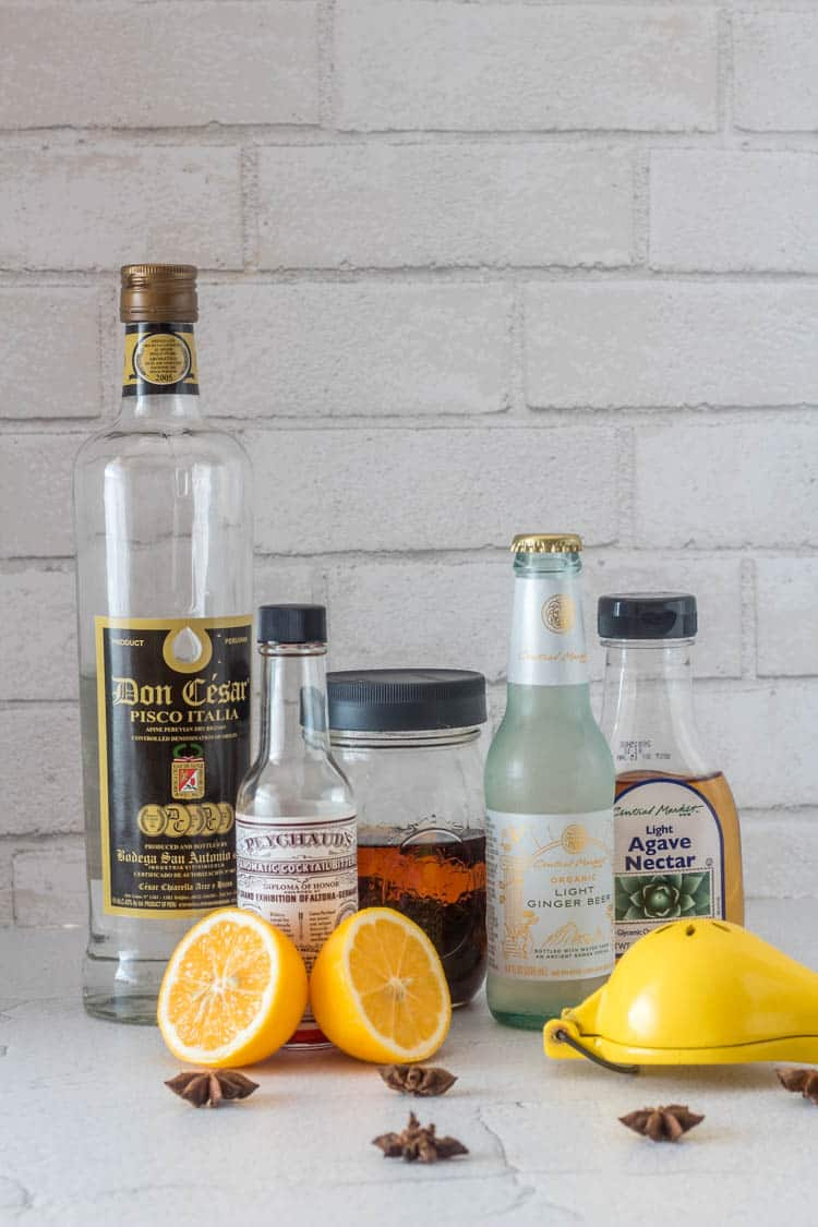 Ingredients for star anise chilcano - pisco Italia, Peychaud's bitters, star anise infused vodka, ginger beer, agave nectar, fresh Meyer lemon.