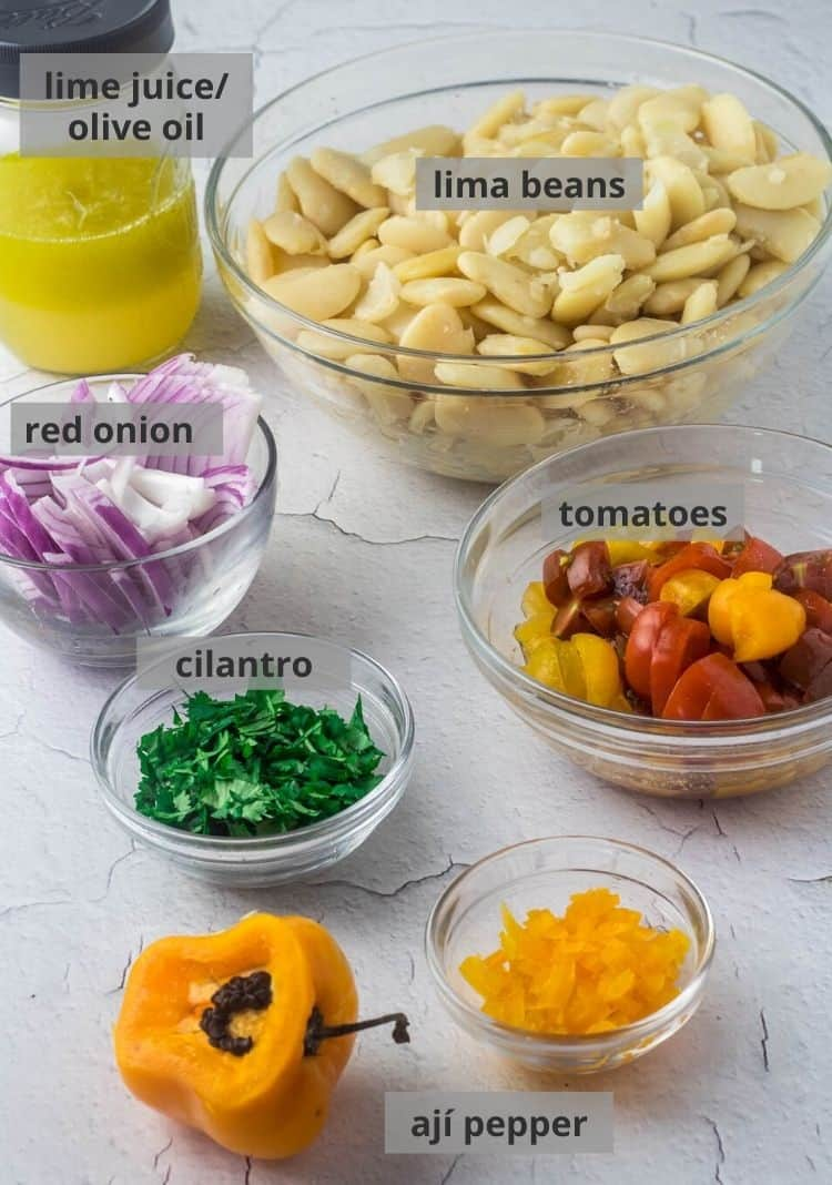 Ingredients for Peruvian Lima Bean Salad - lima beans, tomatoes, rocoto chile, cilantro, red onion, lime juice and olive oil.