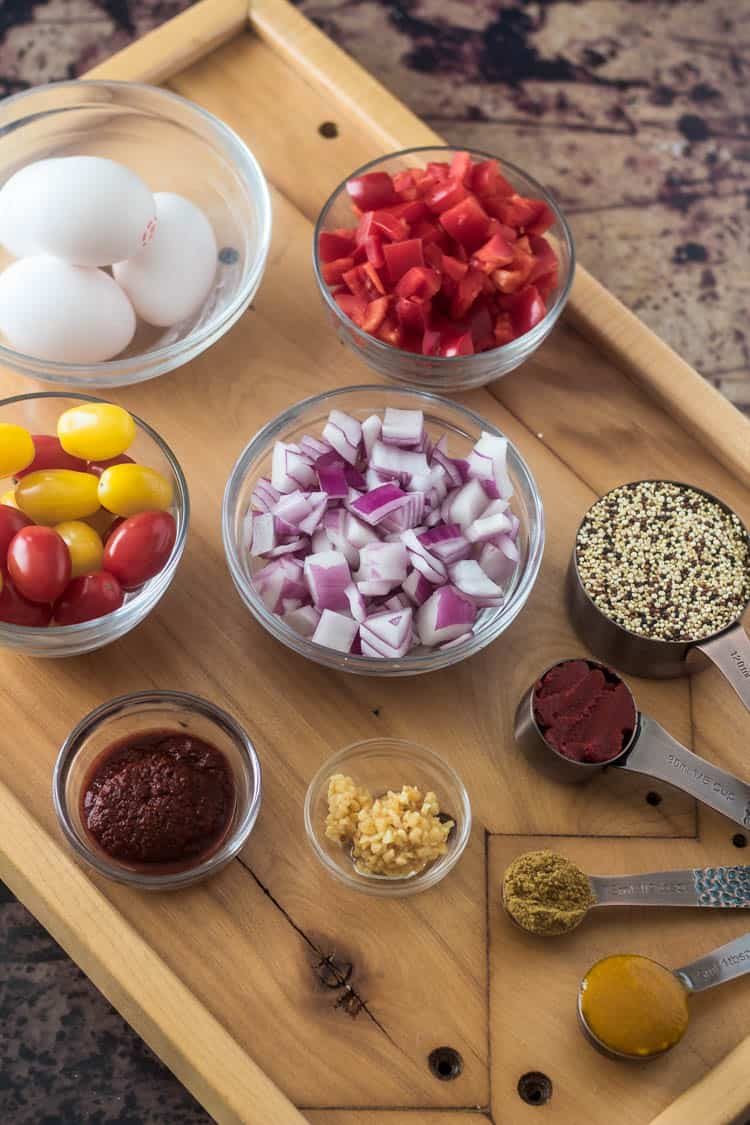 Ingredients for Peruvian quinoa breakfast bowls: red bell pepper, red onion, quinoa, tomato paste, cumin, aji amarillo, garlic, aji panca, tomatoes, eggs.min
