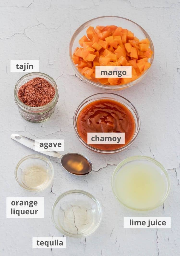 Ingredients for mangonada paletas - mango, chamoy, lime juice, tequila, orange liqueur, agave, tajín.