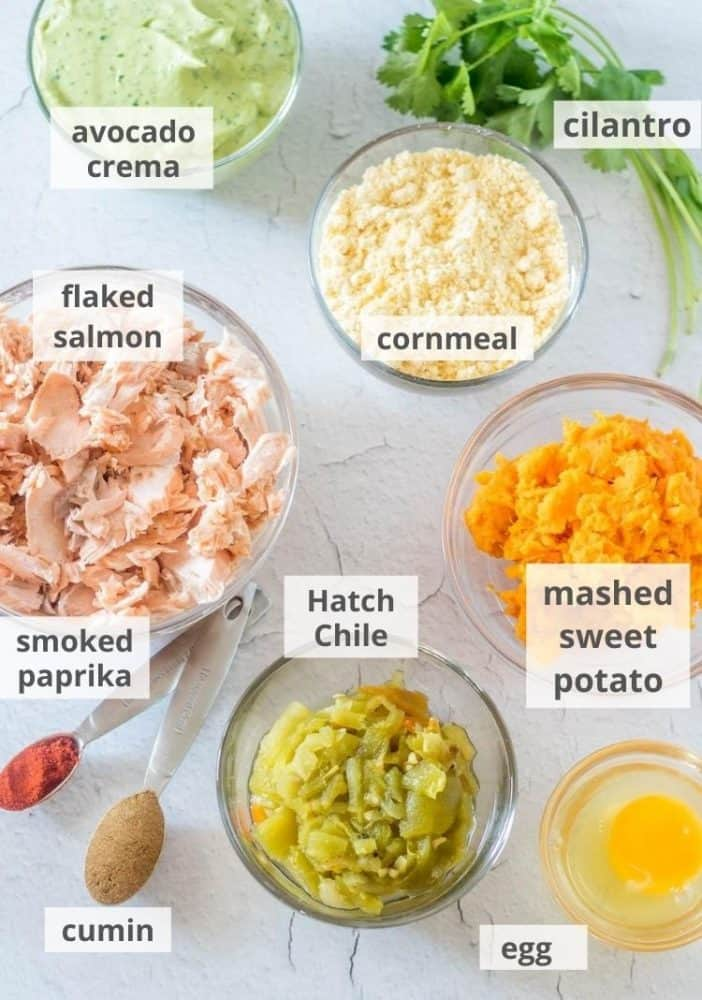Ingredients for Hatch chile salmon cakes: cornmeal, egg, flaked salmon, spices, Hatch green chile.