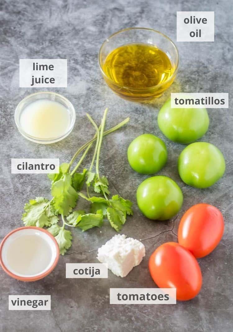 Ingredients: tomatillos, tomatoes, cotija, cilantro lime juice, olive oil, vinegar...